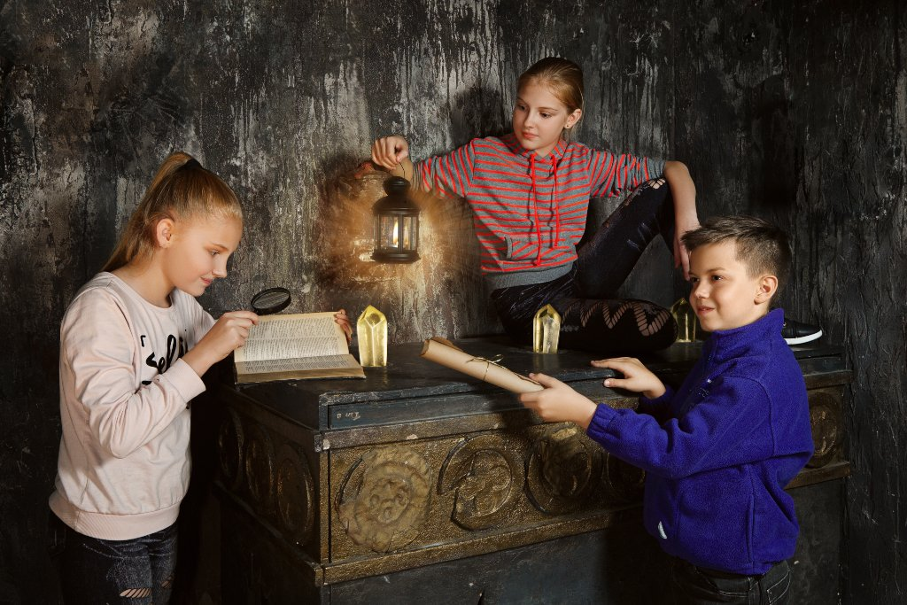 Kids looking for clues in an escape room