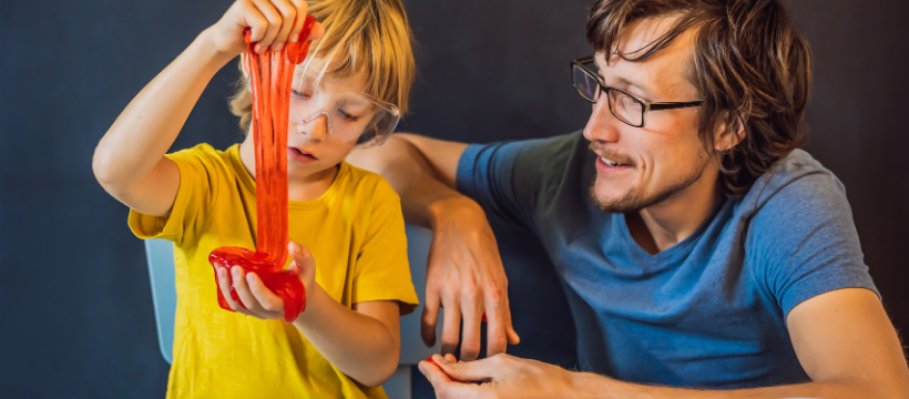 A dad and son doing a science experiment at home